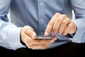 11326201-close-up-of-a-man-using-smartphone